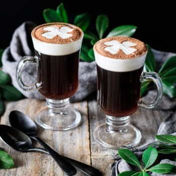 two glasses of non alcoholic Irish coffee with spoons
