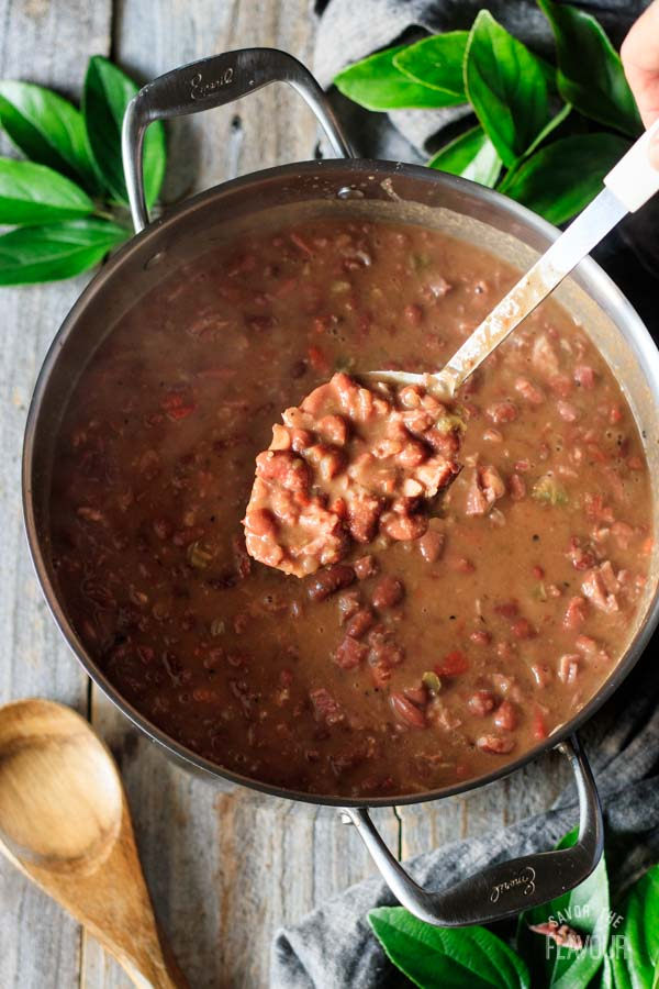 holding a spoonful of red beans and rice