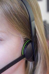 Kid wearing Xbox head set.