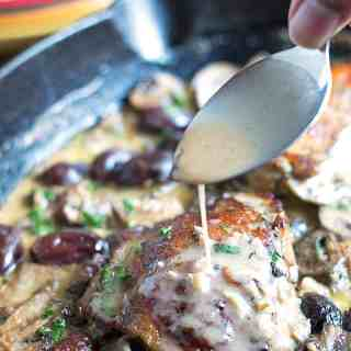 Marinated Roasted Chicken in Wine Mushroom Cream Sauce with Kalamata Olives.