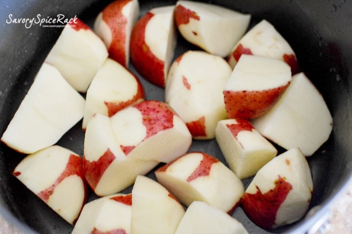 Peel away any bruised areas on the skin areas, and dice the potatoes...