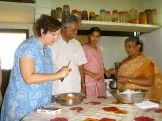 Karen cooking with Mr. Abraham and family - photo - Louise Stirret