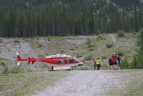 Guests escorted to heliport for the 7 minute flight to Mt. Assiniboine photo - Karen Anderson