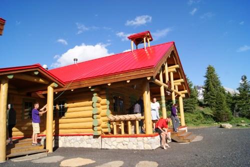 Our friend Kern Jones ringing the dinner bell at Mt. Assiniboine Lodge photo - Karen Anderson