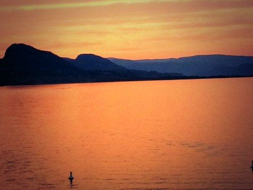 Apricot sunset on Lake Okanagan photo - Karen Anderson