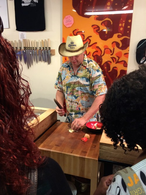 Knifewear owner Kevin Kent teaching my Calgary Food Tours' guests a few knife skills - photo - Karen Anderson