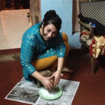 My friend Tilly Sanchez demonstrates how to use a coconut scraper - photo - Karen Anderson