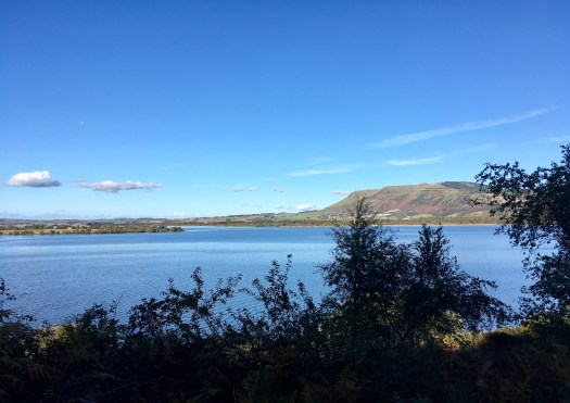 A glimpse of Saint Serf's Inch Island can be seen in the middle of Loch Leven