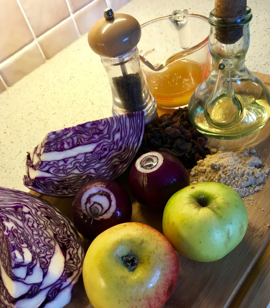 Red cabbage and apples help to make a colourful display of all the ingredients required to make the perfect braised, red cabbage