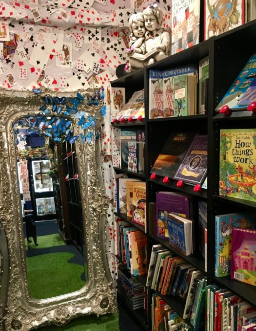 An elaborate mirror, decorated with blue butterflies adds a very 'Wonderland' dimension to the shop