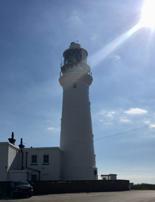 An image of Flamborough Head Lighthouse against a blue sky