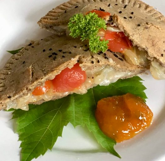 Buckwheat pastry with cheese, onion, tomatoes and homemade mango chutney
