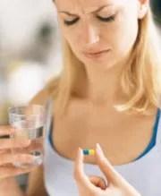 Woman-taking-a-pill