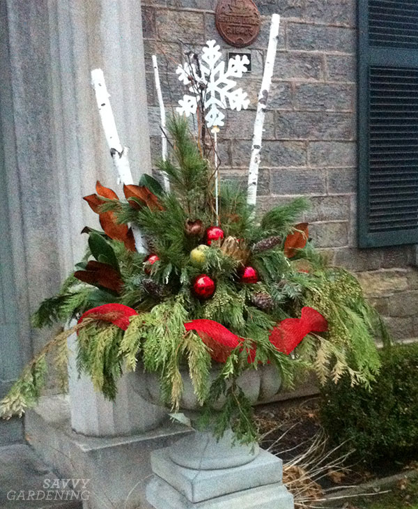 weave ribbon in your holiday container arrangement