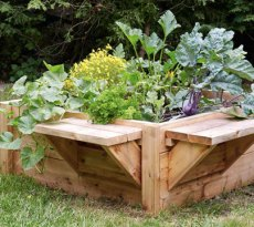Raised bed designs for gardening: This raised bed with benches is the right height to keep out bunnies and groundhogs—and you can rest on the benches in between puttering in the garden.