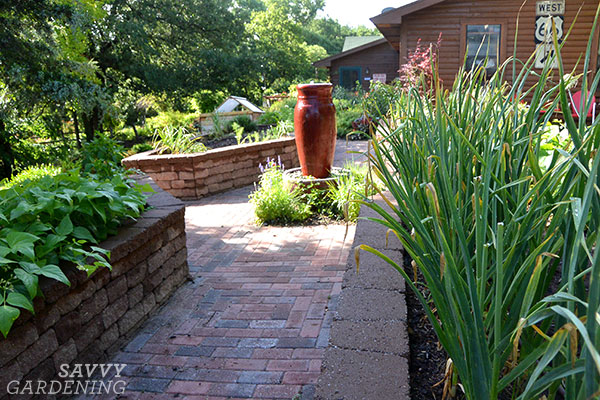 raised beds made from salvaged paving stones