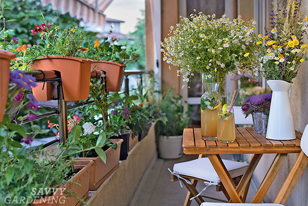 sit-on-top planters on a balcony