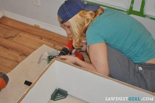 Fawn building bookshelves