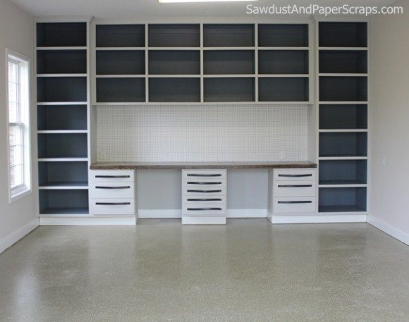 Garage-Workshop-with-Wood-Countertop-and-Painted-Cabinets-580x457