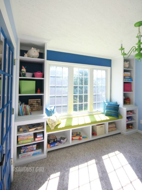 Playroom built-in window seat and storage. https://sawdustdiaries.com