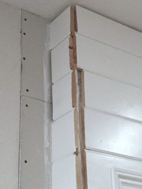 uneven ends on plank wall
