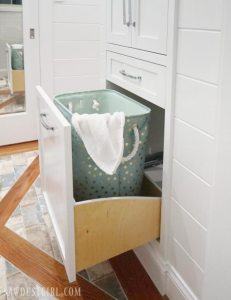 Bathroom linen closet with pull out hamper