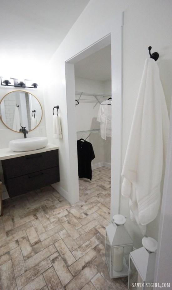herringbone tile bathroom floor