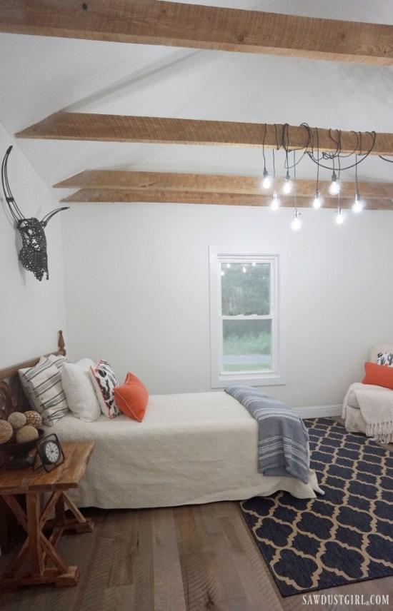 Awesome bedroom, blue and orange bedroom, cafe lights on wood beam