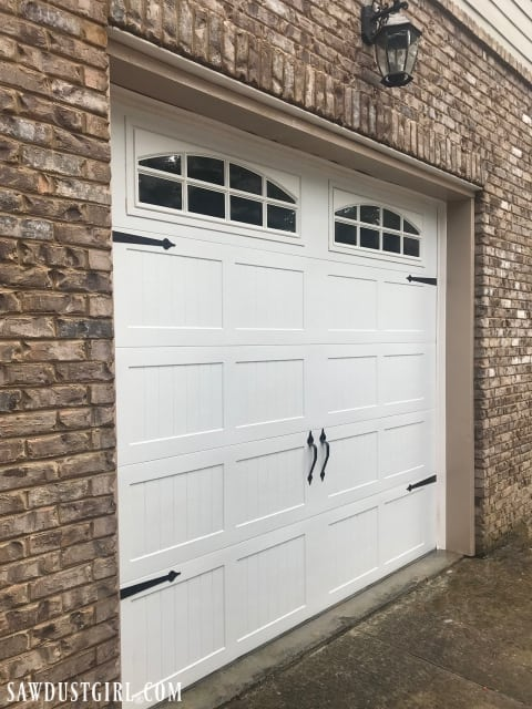 Clean a garage door with household cleaners