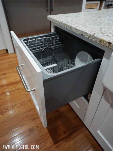 Built-in dishwasher drawer. Looks like a cabinet drawer!