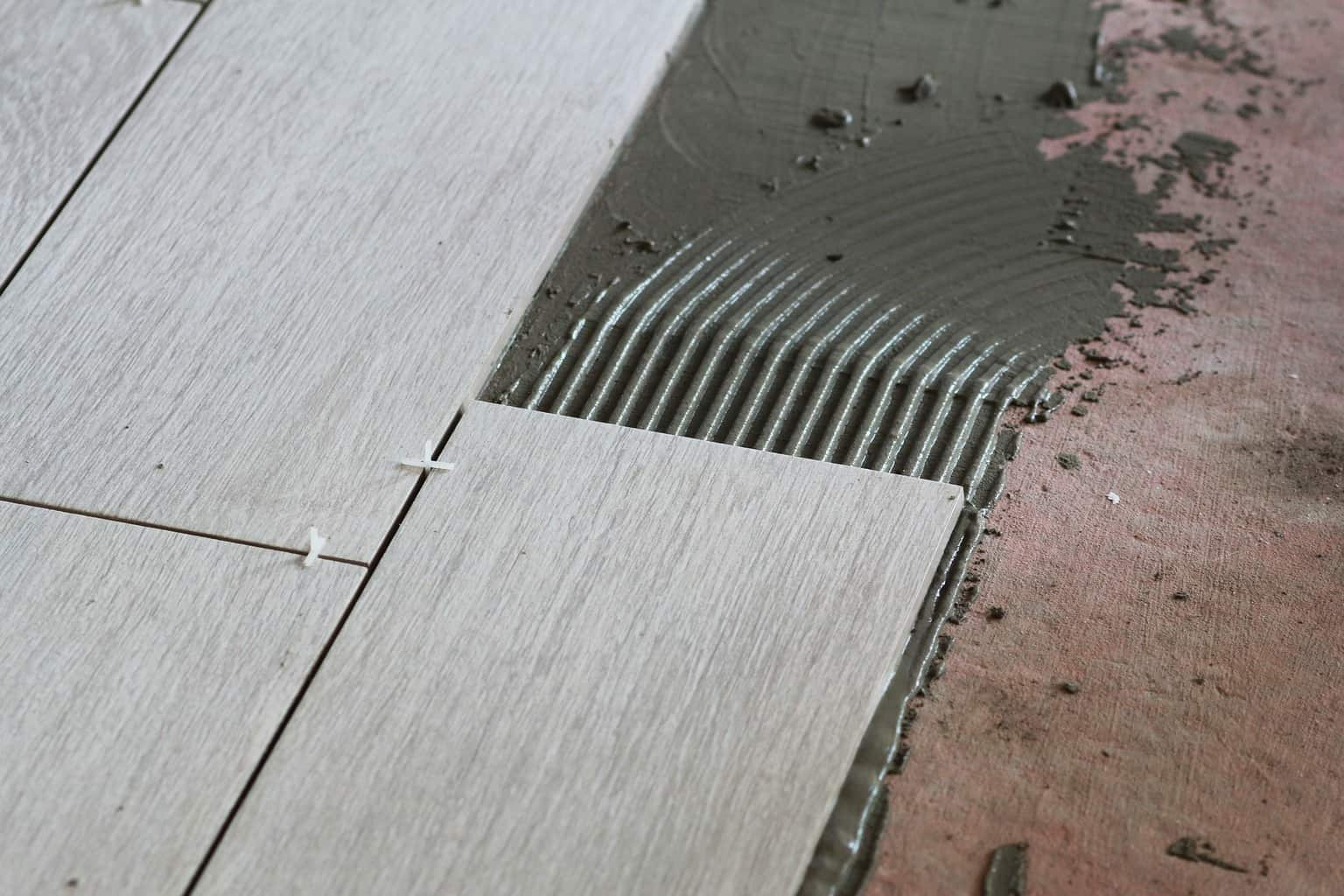 how to remove tile glue adhesive and