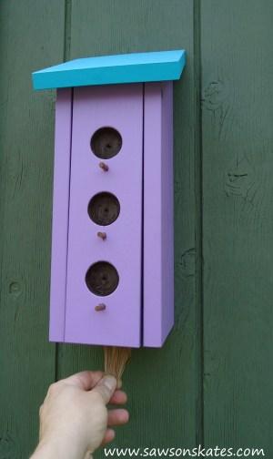 Birdhouse Poop Bag Dispenser in use