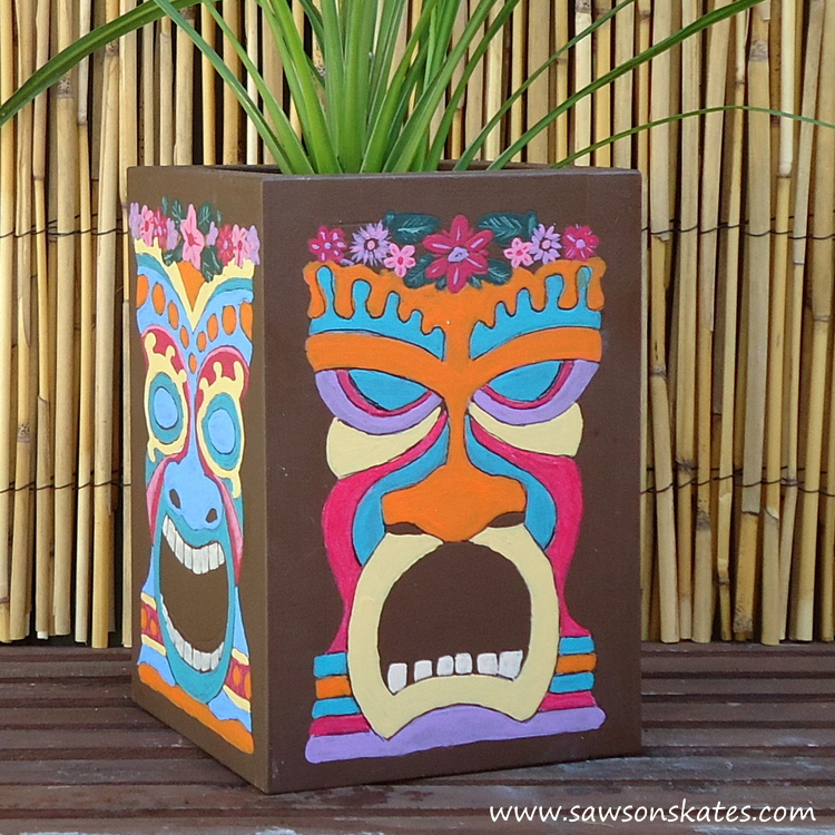 Love this colorful DIY tiki planter! The plan is so easy to follow, it's made with scrap wood and the tiki faces were traced on the container, so painting them is nearly goof proof! Definitely making this!