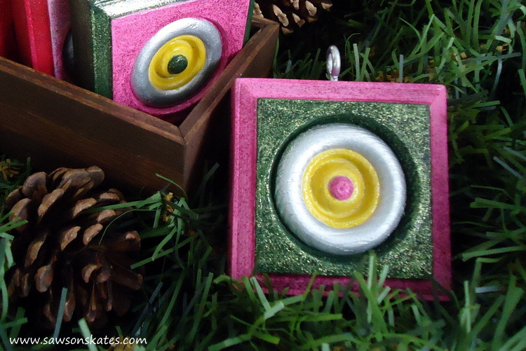 Wood rosettes are transformed into DIY Christmas ornaments. So easy and they make great gifts!