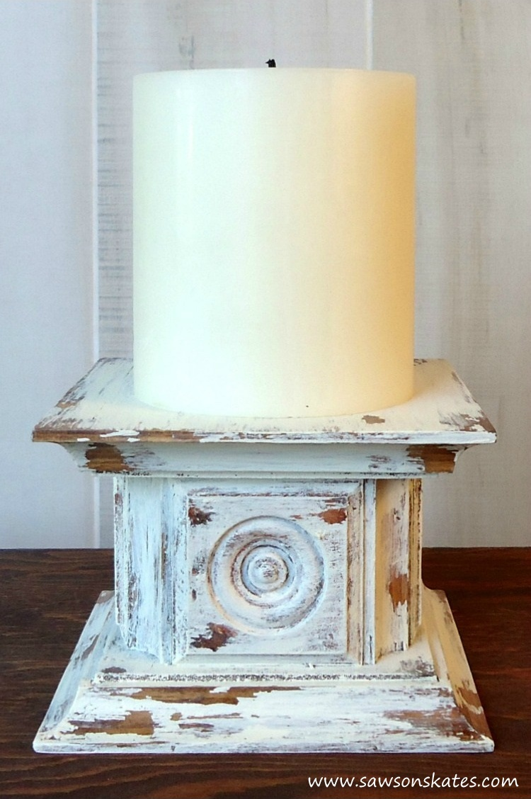 Looking for easy DIY candle holder ideas? Look no further than this antique style pillar candle holder featuring wooden rosettes and a chippy paint finish! Make it for yourself or give as a gift.