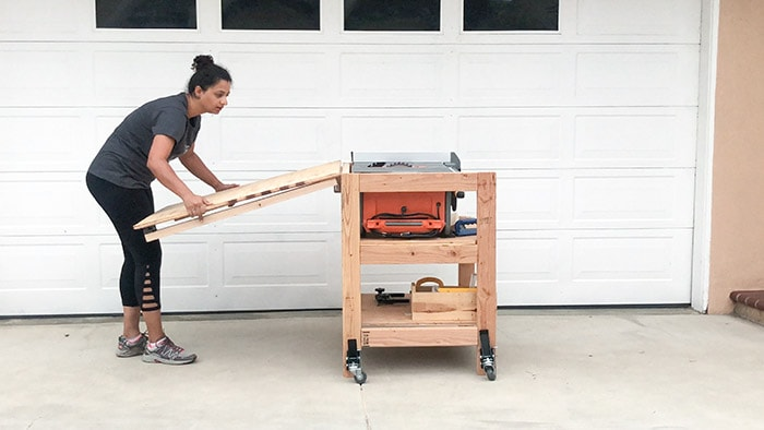 7 DIY Table Saw Stations for a Small Workshop - DIY Table Saw Stand With Folding Outfeed Table by Anika's DIY Life