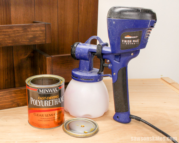 Spray polyurethane with a paint sprayer rather than applying with a paintbrush for a quick, easy, professional looking finish on DIY furniture projects.