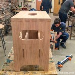 Students assembling a bench at a woodworking class for beginners