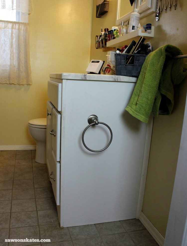Check out the plans for this small DIY vanity. Bathroom before