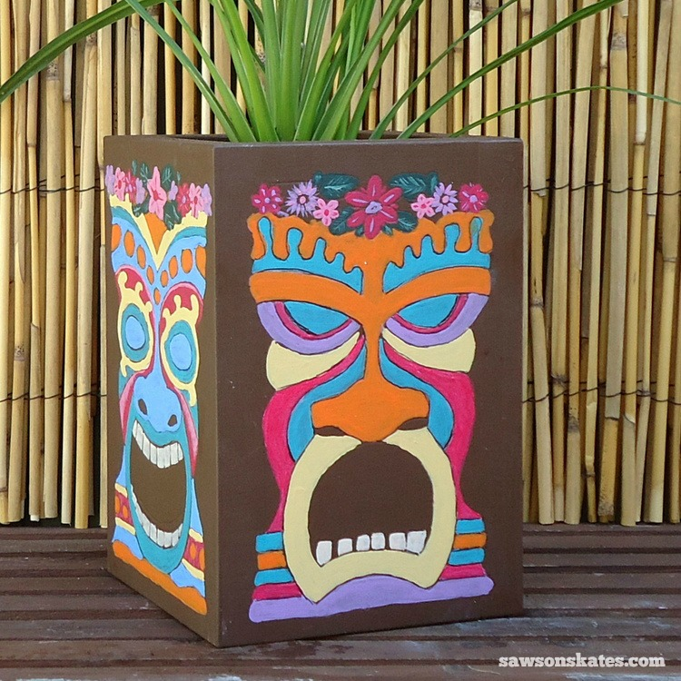 These wooden DIY outdoor planters are practically FREE... they're all made with scrap wood - Wooden Tiki Mask Planter