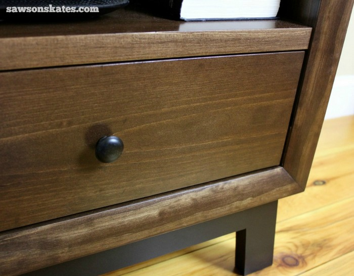 My retro nightstand features angled legs, storage shelf and a deep drawer for lots of storage. Window/door casing moulding is used to make the face frame and gives this project a thick, chunky look.