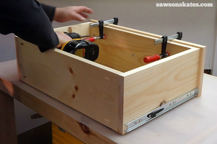 Remove the Retro Nightstand drawer, drill countersink holes and attach the drawer box to the drawer front using 1-1/4