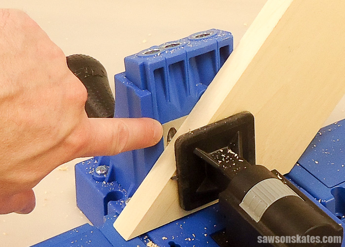 Drilling pocket holes on miter joints - Take a look at this setup. The hole is exposed. If we were to drill a pocket hole in this board right now we would drill through the edge or side of the board.