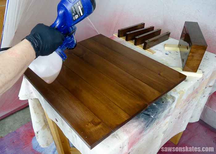 Wall-mounted DIY wine bar was finished by spraying the piece with polyurethane