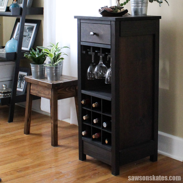 This DIY wine cabinet attractively displays entertaining essentials like wine bottles and wine glasses and a drawer provides a place to store accessories.