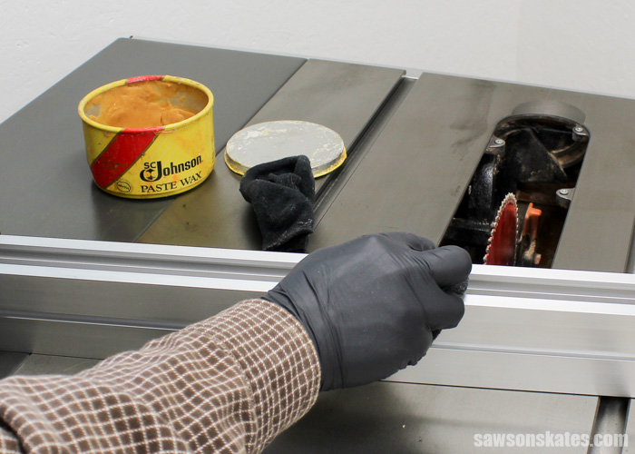 Wax your table saw - apply wax to the bottom of the rip fence and to the miter gauge