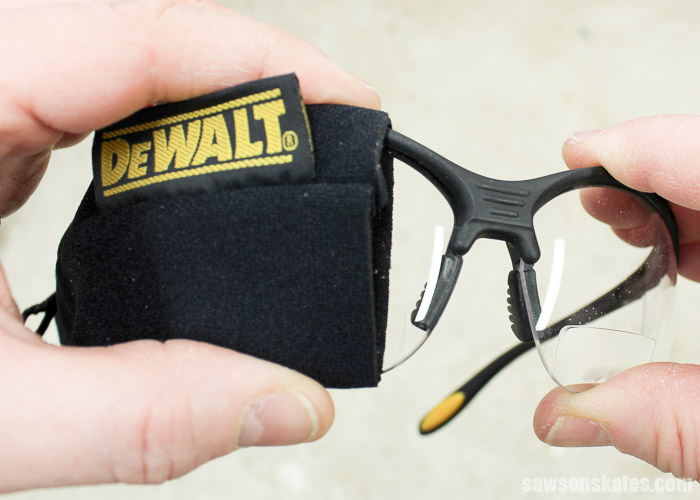 These bifocal safety glasses includes a protective sleeve.
