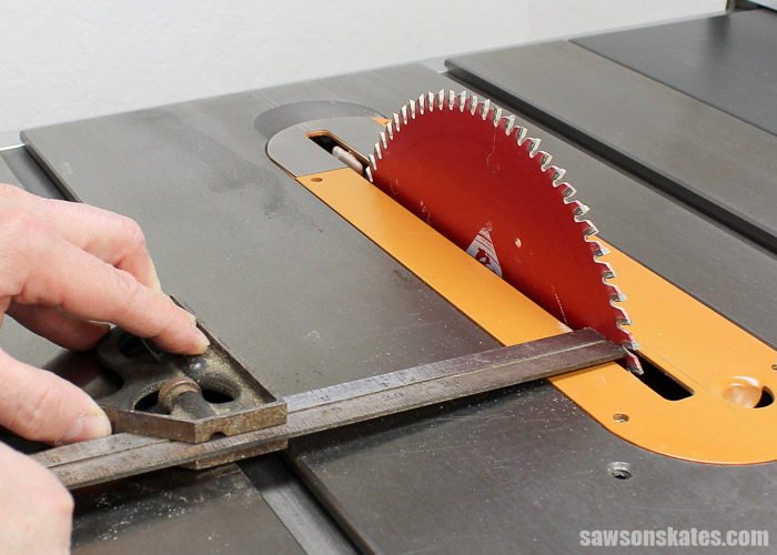 Tune Up Your Table Saw - Place a combination square in the miter gauge slot, against the saw blade and measure the distance