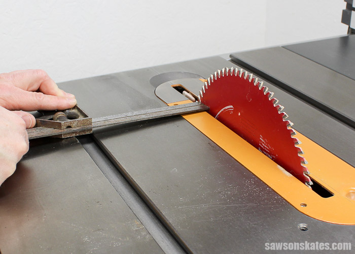 Tune Up Your Table Saw - Turn the blade so the mark you made earlier is now at the back of the saw. Move the combination square to the back and again measure the distance