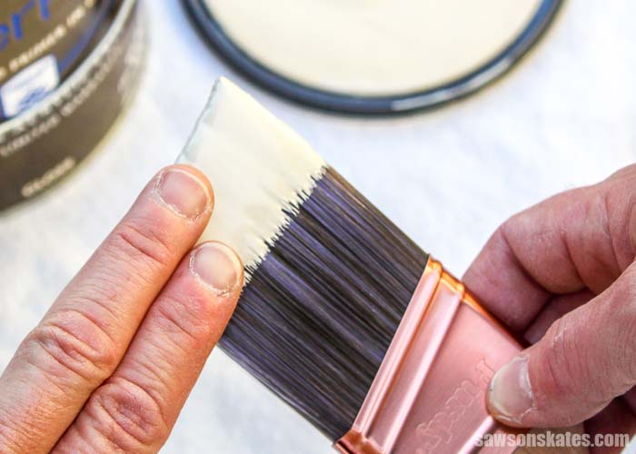 Loading the brush with about the width of two-and-half fingers helps to prevent getting paint in the ferrule. Keeping paint out of the ferrule makes the brush easier to clean.